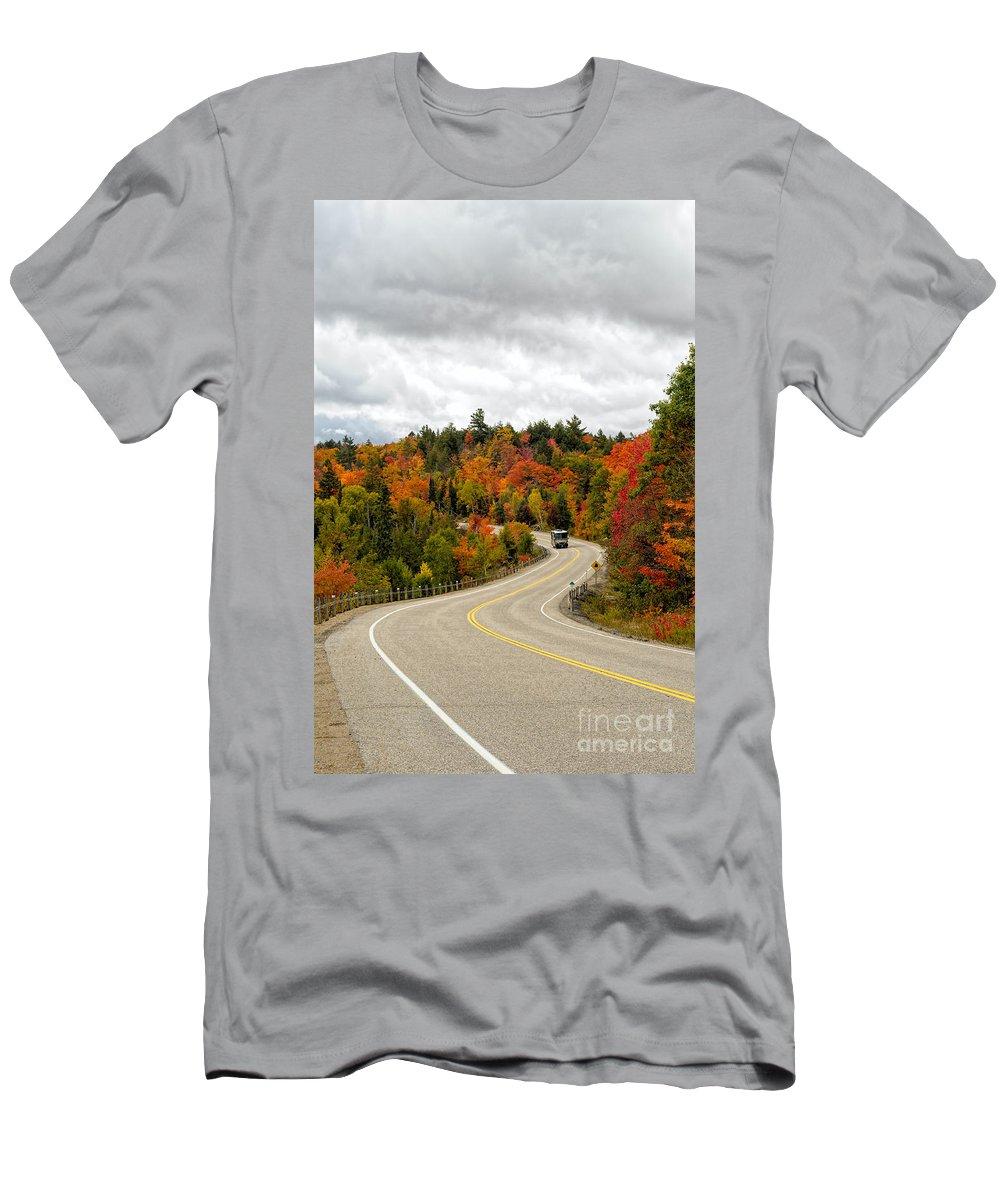 Algonquin Men's T-Shirt (Athletic Fit) featuring the photograph Driving Through Algonquin Park In Fall by Les Palenik