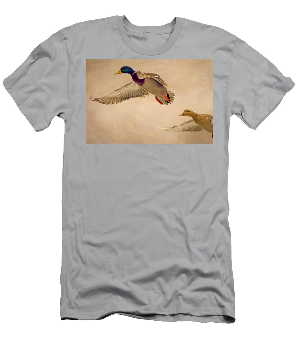 Duck Men's T-Shirt (Athletic Fit) featuring the photograph Ducks In Flight by Bob Orsillo
