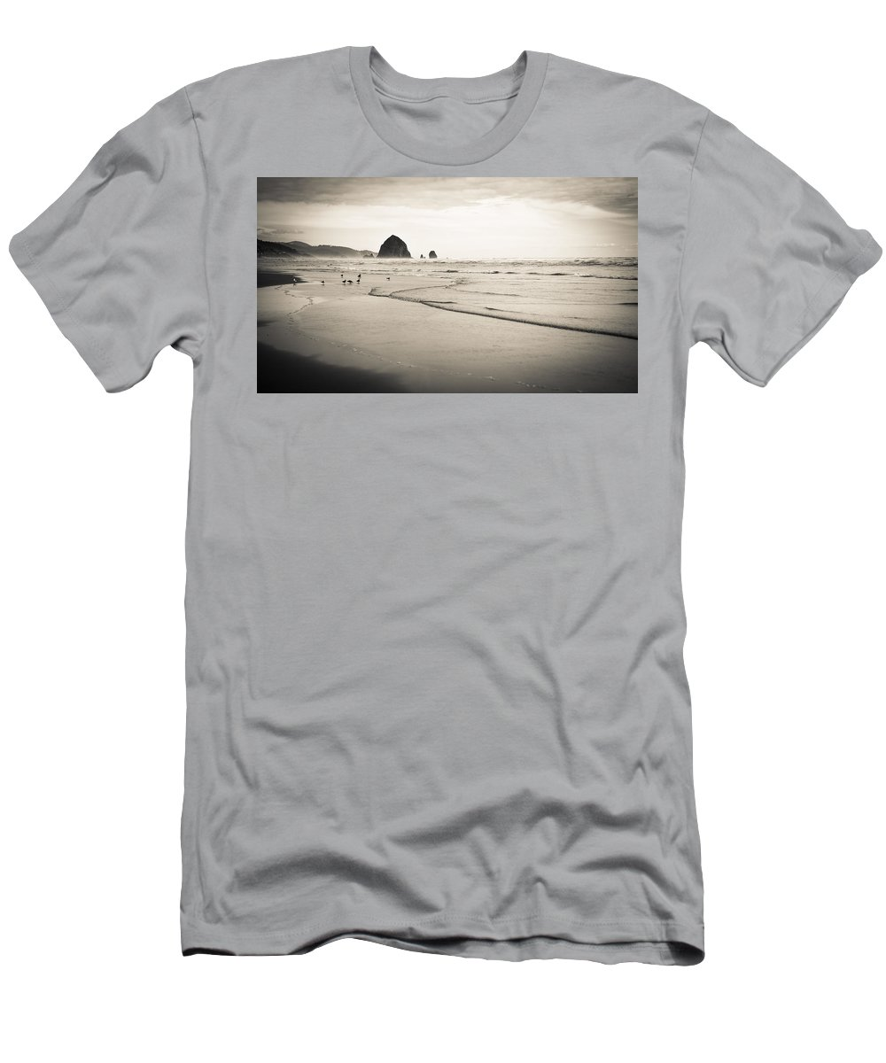 The Needles Men's T-Shirt (Athletic Fit) featuring the photograph Haystack Rock And Cannon Beach by Scott Rackers