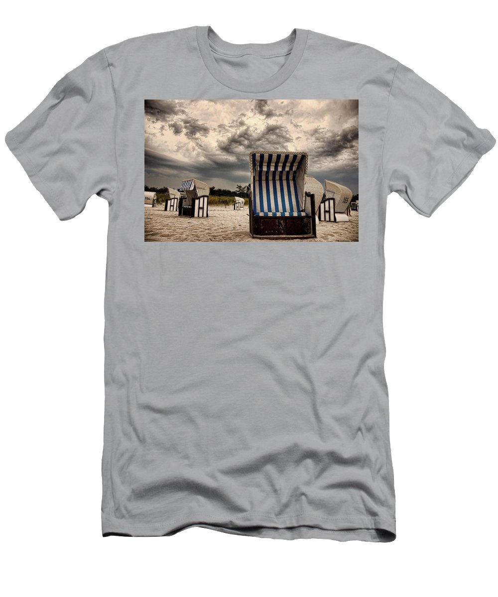 Ostsee Strand Sea Water Weather Clouds Strandkorb Stormy Thunderstorm Heavy Meer Sonne Urlaub Wasser Men's T-Shirt (Athletic Fit) featuring the photograph Heavy Times by Steffen Gierok