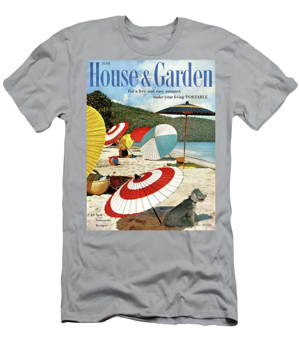 Exterior T-Shirt featuring the photograph House And Garden Featuring Umbrellas On A Beach by Otto Maya & Jess Brown