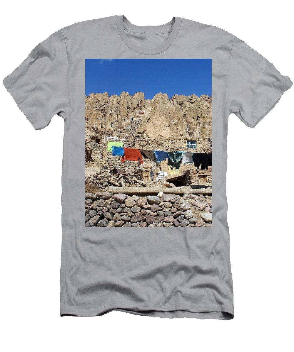 Kandovan Men's T-Shirt (Athletic Fit) featuring the photograph Iran Kandovan Stone Village Laundry by Lois Ivancin Tavaf