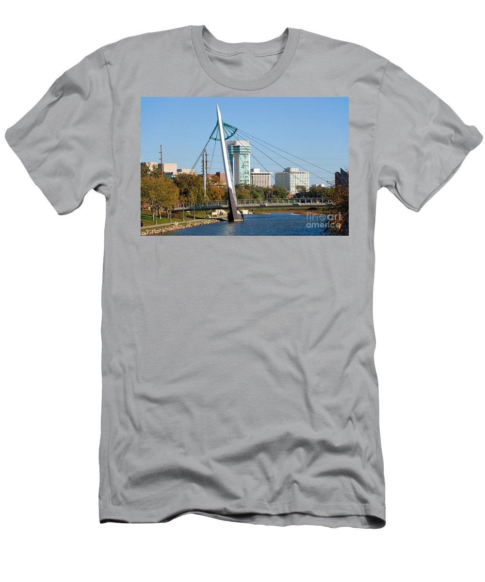 Arkansas River Men's T-Shirt (Athletic Fit) featuring the photograph Pedestrian Bridge Over Arkansas River In Wichita by Bill Cobb
