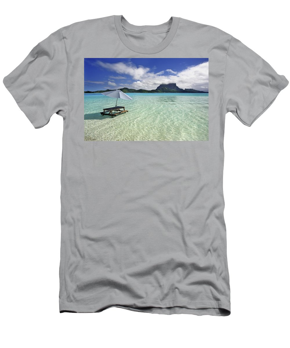 Above Men's T-Shirt (Athletic Fit) featuring the photograph Picnic Table And Umbrella In Clear Lagoon by M Swiet Productions