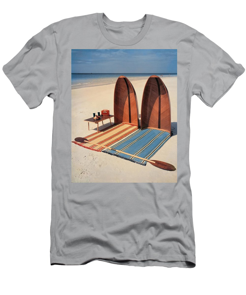 Accessories T-Shirt featuring the photograph Pixie Collapsible Boat On The Beach by Lois and Joe Steinmetz