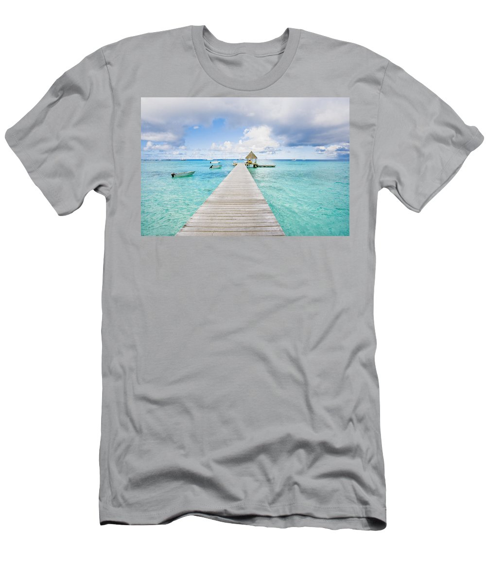 Afternoon Men's T-Shirt (Athletic Fit) featuring the photograph Rangiroa Atoll Pier On The Ocean by M Swiet Productions
