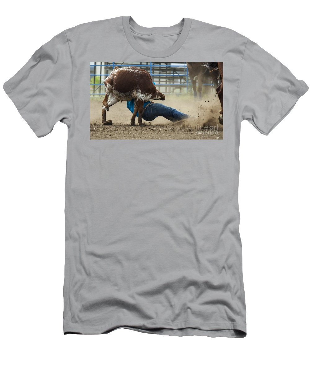 Cowboy Men's T-Shirt (Athletic Fit) featuring the photograph Rodeo Getting Down by Bob Christopher