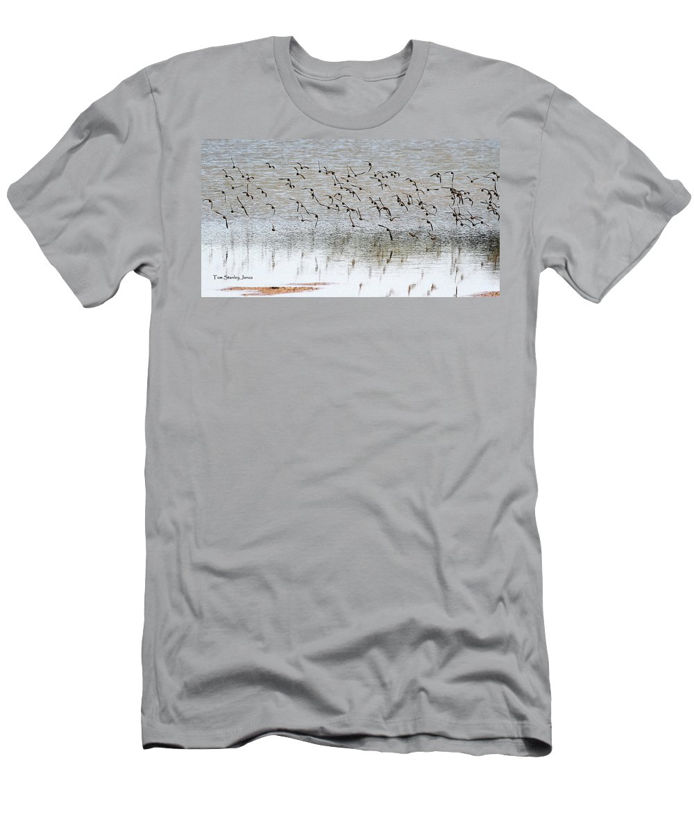 Sand Pipers In Flight Men's T-Shirt (Athletic Fit) featuring the photograph Sand Pipers In Flight by Tom Janca