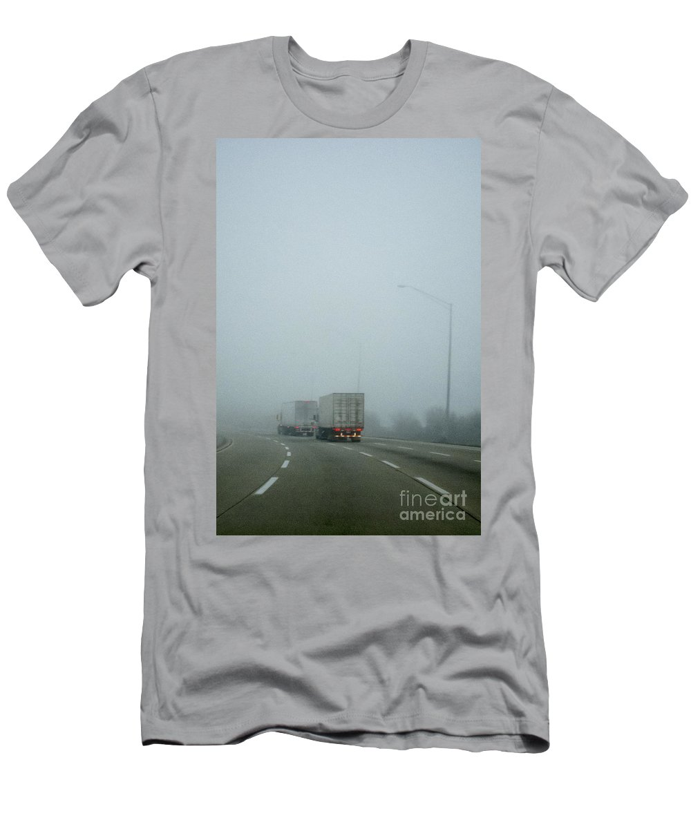 Road; Roadway; Highway; Interstate; Lanes; Day; Daytime; Lines; Fog; Foggy; Black; Asphalt; Cement; Shroud; Truck; Semi; Trailer; Transportation; Transport; Two; Back; Taillights; Lights; Curve; Bend; Street Lights Men's T-Shirt (Athletic Fit) featuring the photograph Semis by Margie Hurwich