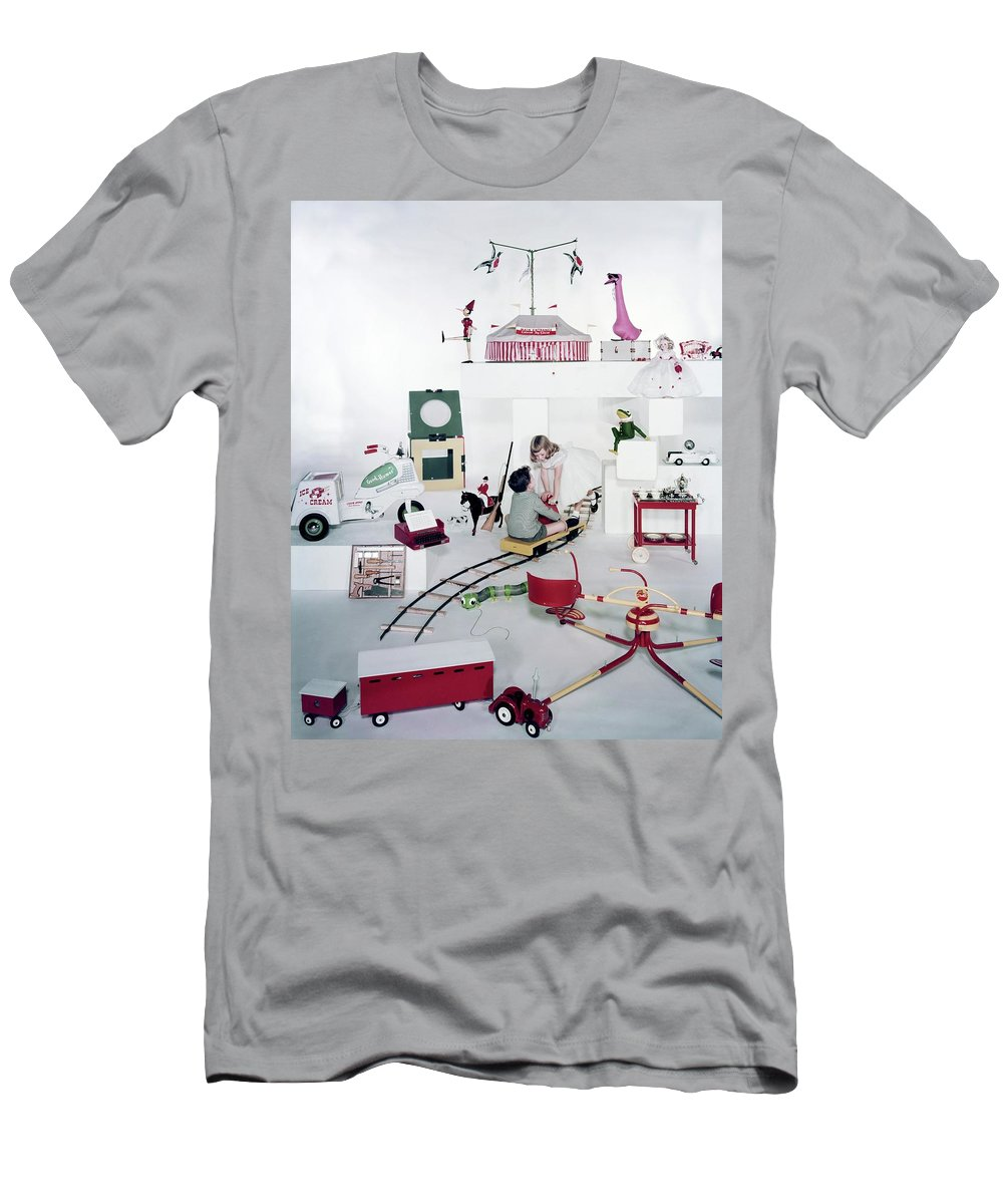 Studio Shot T-Shirt featuring the photograph Two Children Playing With Vintage Toys by Bruce Knight