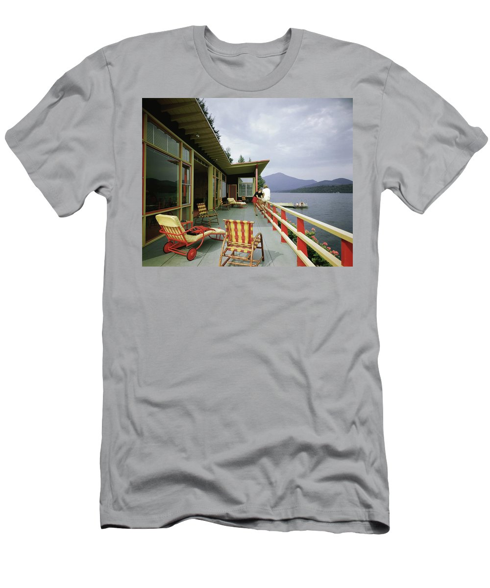 Alfred Rose T-Shirt featuring the photograph Two Women On The Deck Of A House On A Lake by Robert M. Damora