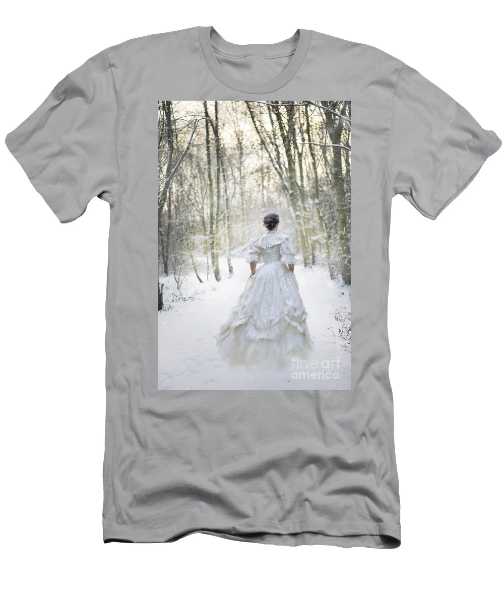 Woman Men's T-Shirt (Athletic Fit) featuring the photograph Victorian Woman Running Through A Winter Woodland With Fallen Sn by Lee Avison