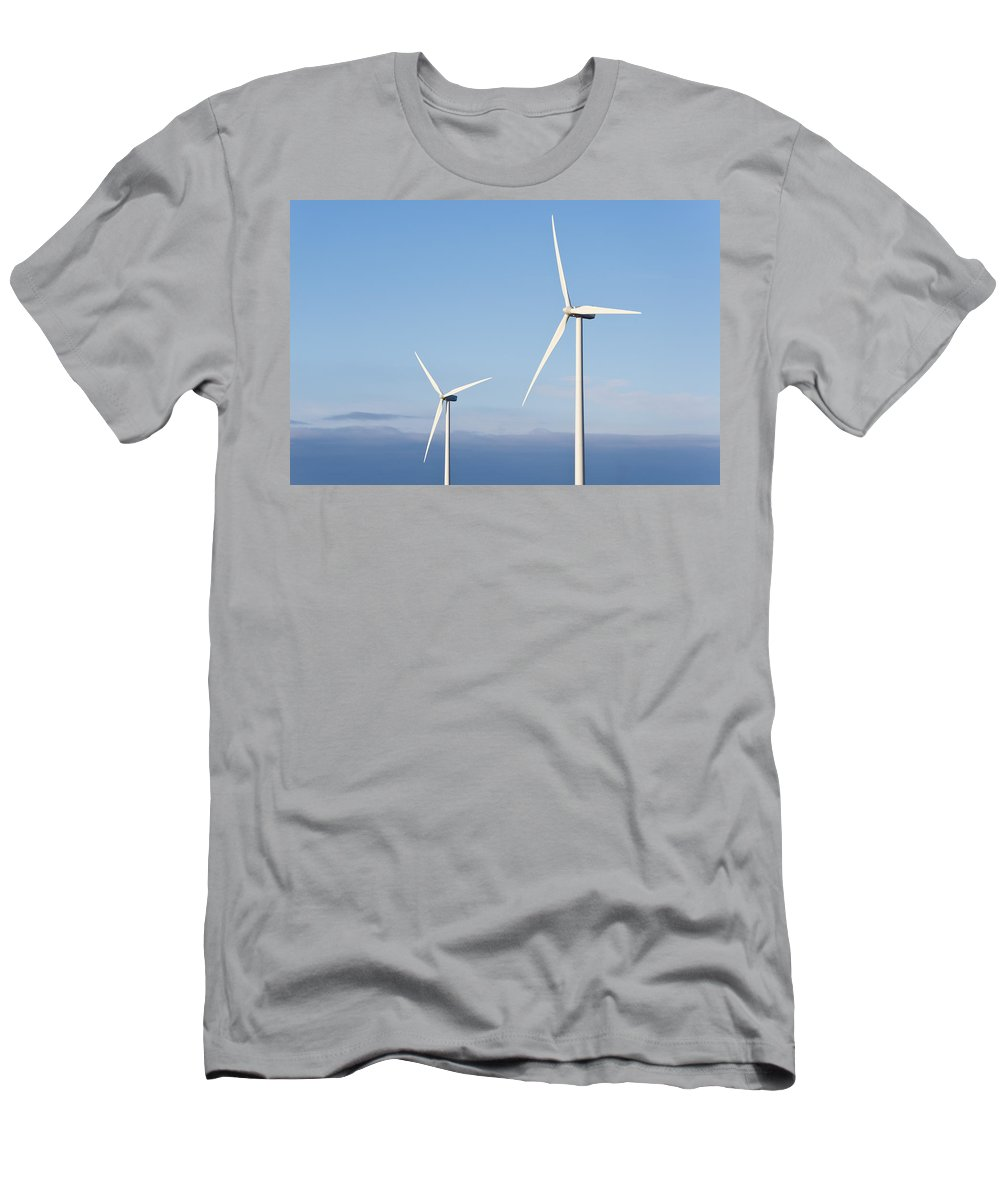 Alternative Energy Men's T-Shirt (Athletic Fit) featuring the photograph Wind Turbines In The Air by David Head
