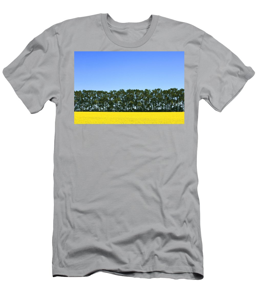 Agriculture Men's T-Shirt (Athletic Fit) featuring the photograph Canola Field And Trees by Dean Muz