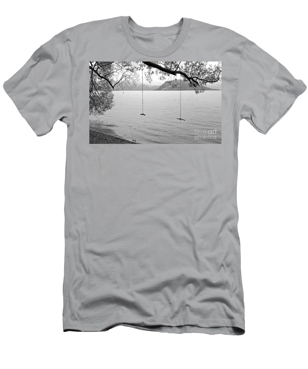 Rainy Day Men's T-Shirt (Athletic Fit) featuring the photograph Empty Swings In The Rain by Carole Lloyd