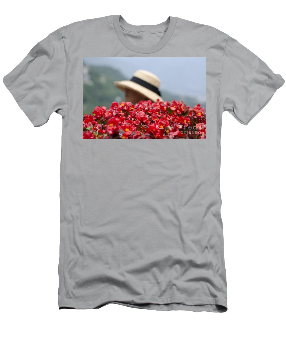 Red Men's T-Shirt (Athletic Fit) featuring the photograph Red Flowers And Straw Hat by Mats Silvan