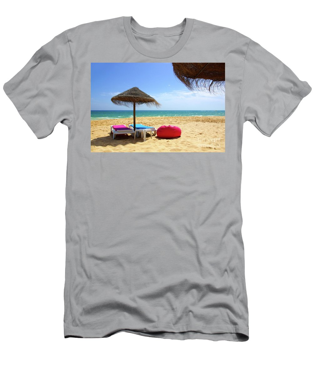 Bay Men's T-Shirt (Athletic Fit) featuring the photograph Straw Umbrellas by Carlos Caetano