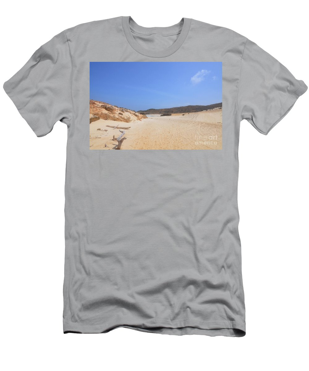 Driftwood Men's T-Shirt (Athletic Fit) featuring the photograph Driftwood Abandoned On A Beautiful Remote Beach In Aruba by DejaVu Designs