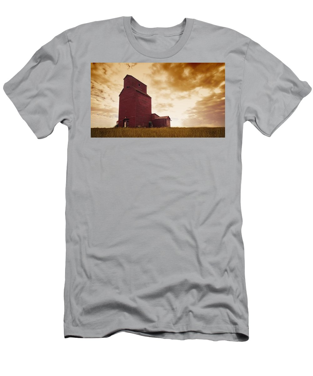 Agriculture Men's T-Shirt (Athletic Fit) featuring the photograph Grain Elevator by Kelly Redinger