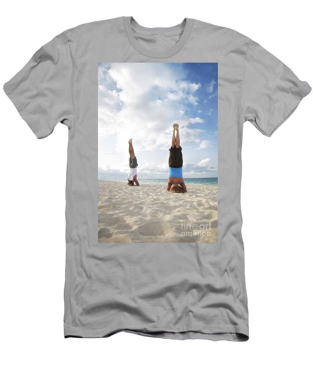 Active Men's T-Shirt (Athletic Fit) featuring the photograph Headstand On Beach by Brandon Tabiolo - Printscapes