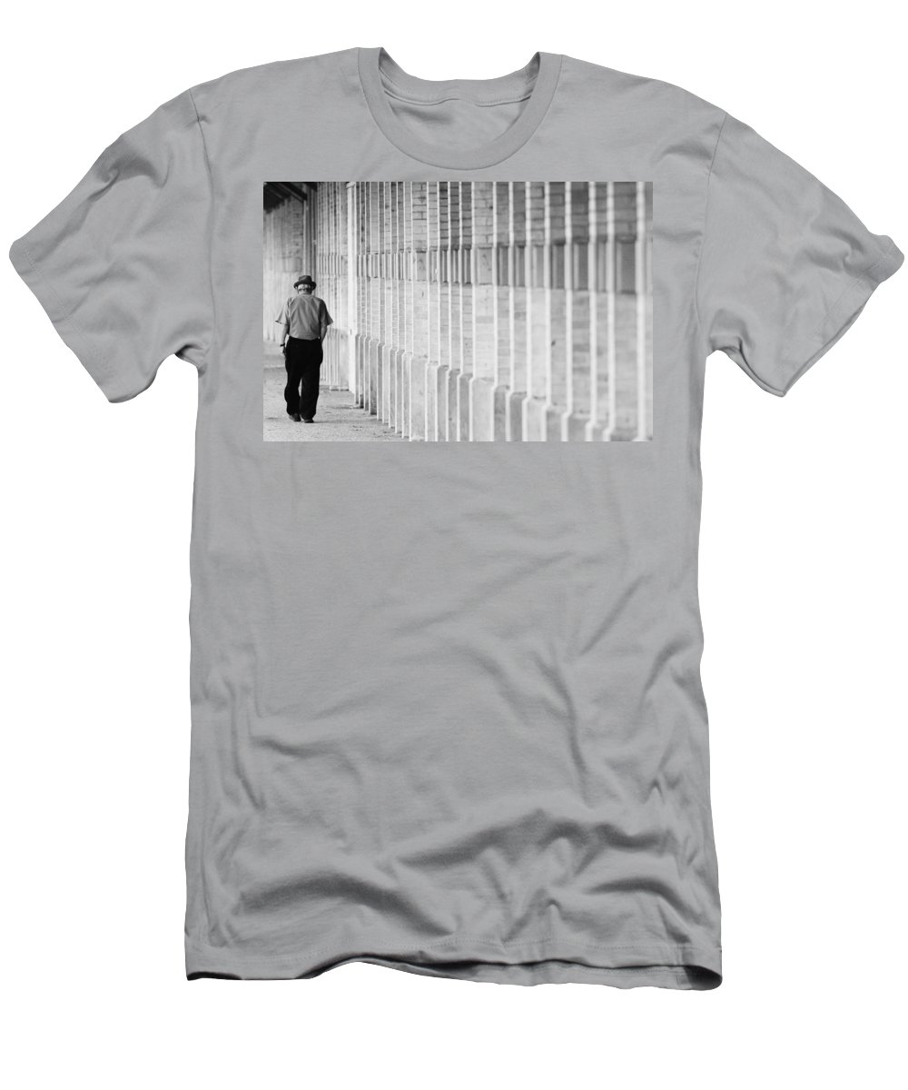 City Men's T-Shirt (Athletic Fit) featuring the photograph Man Walking by Jill Reger