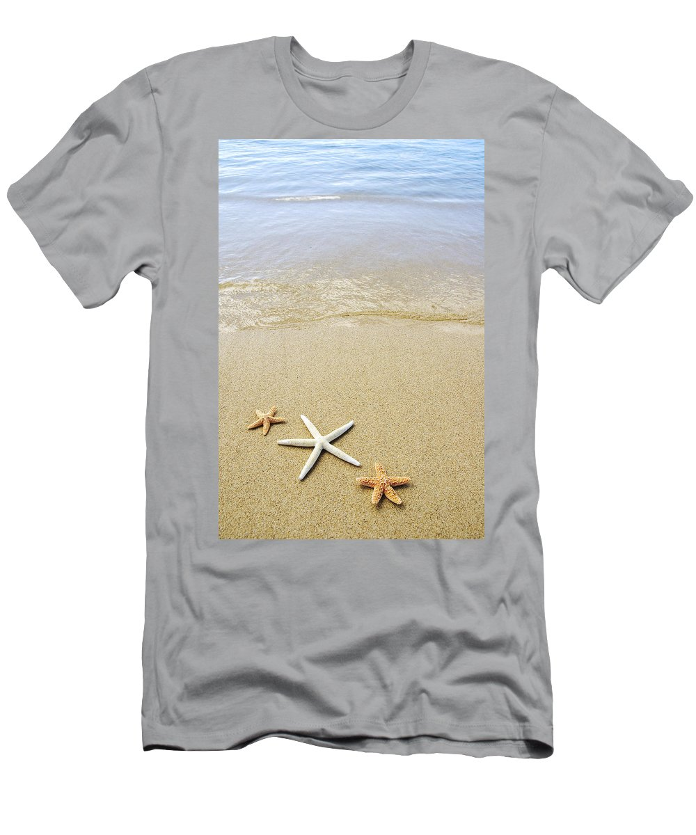 Afternoon Men's T-Shirt (Athletic Fit) featuring the photograph Starfish On Beach by Mary Van de Ven - Printscapes