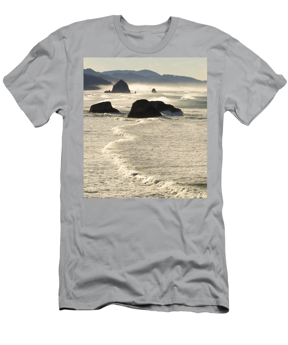 Cannon Beach Men's T-Shirt (Athletic Fit) featuring the photograph Waves Roll Ashore On The Oregon Coast by John Trax