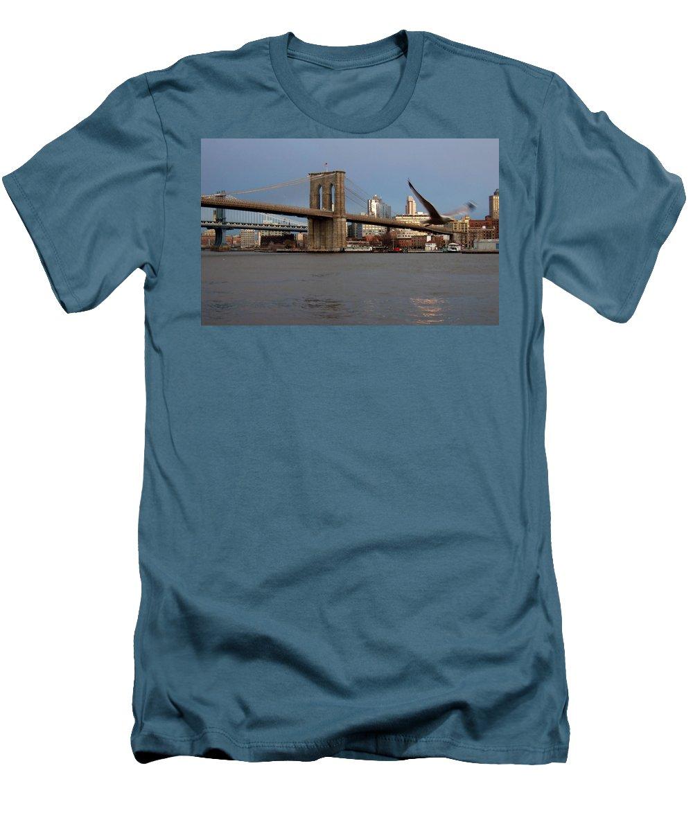Brooklyn Bridge Men's T-Shirt (Athletic Fit) featuring the photograph Brooklyn Bridge And Bird In Flight by Anita Burgermeister