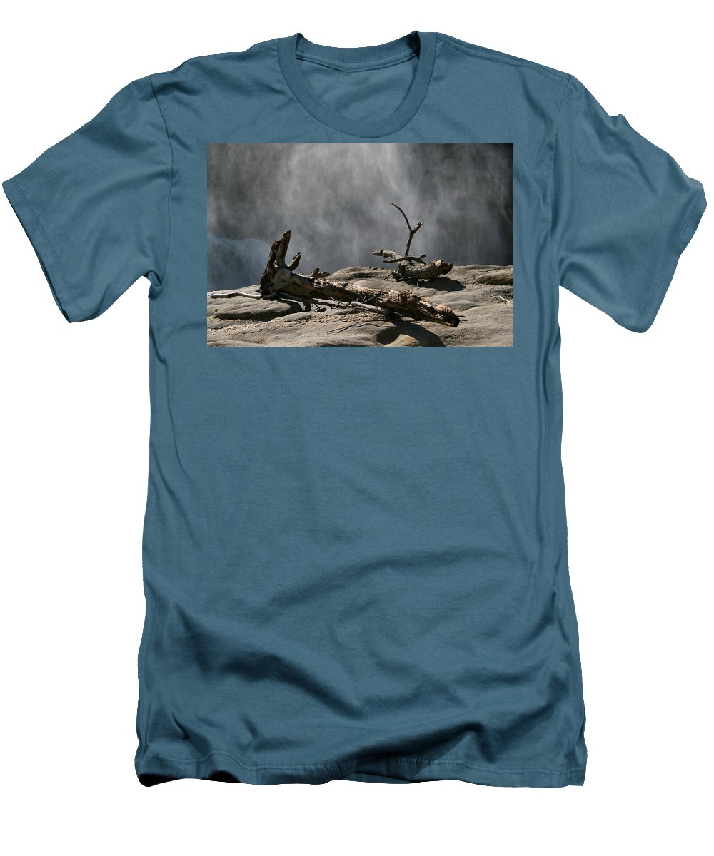 Wood Drift Driftwood Rock Mist Waterfall Nature Sun Sunny Waterful Glow Rock Old Aged Men's T-Shirt (Athletic Fit) featuring the photograph Driftwood by Andrei Shliakhau