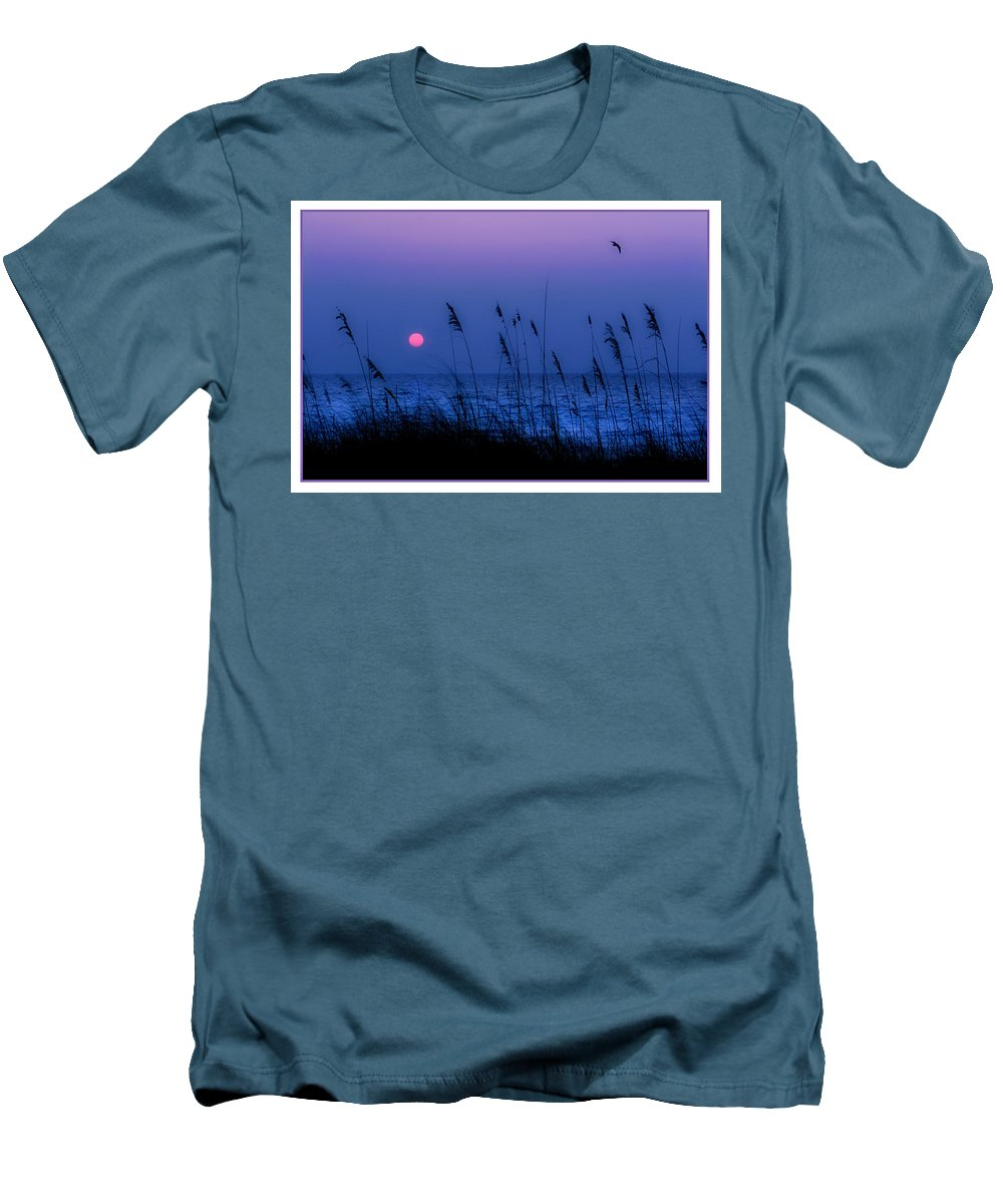 Grass Men's T-Shirt (Athletic Fit) featuring the photograph Grasses Frame The Setting Sun In Florida by Mal Bray