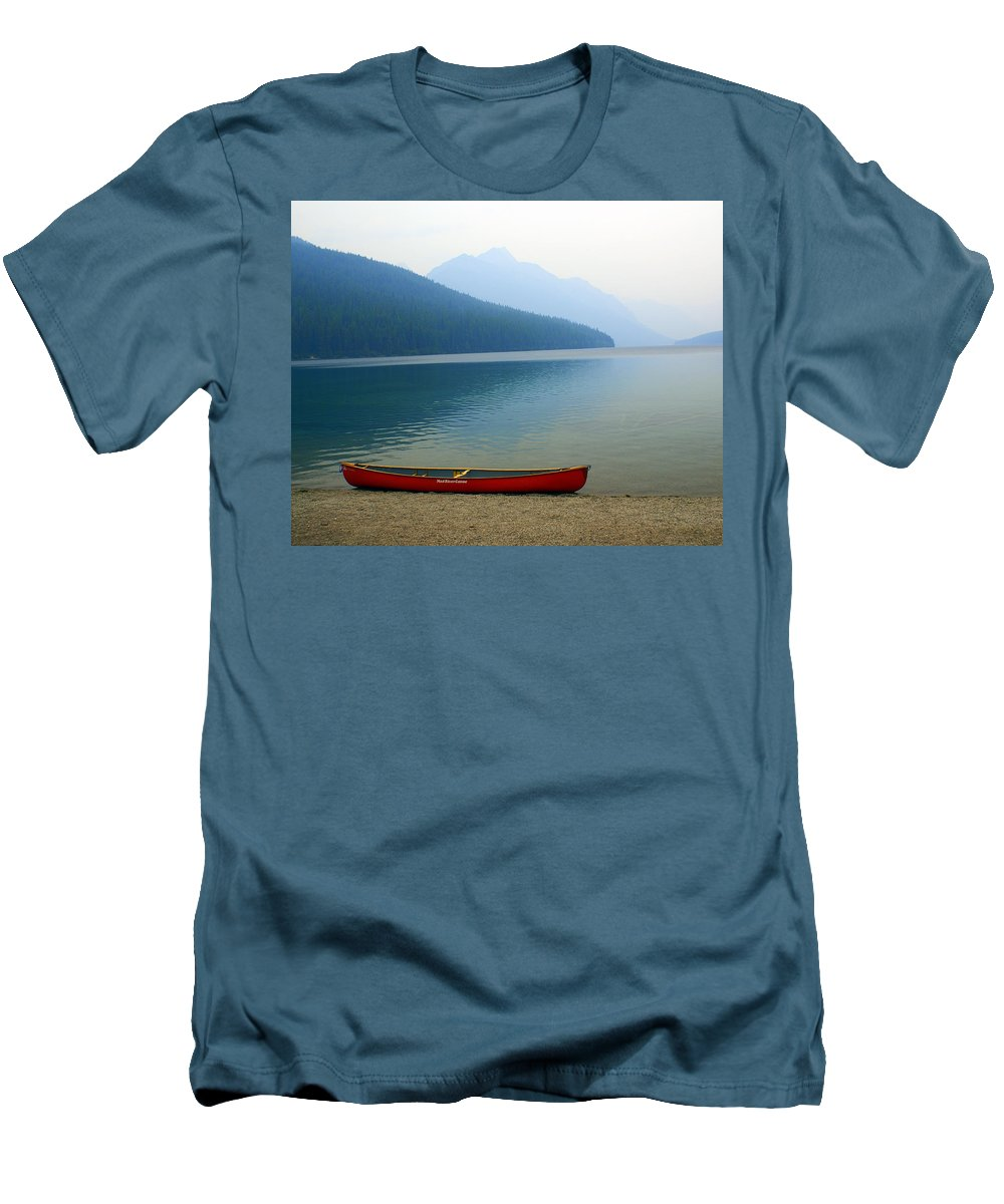 Glacier National Park Men's T-Shirt (Athletic Fit) featuring the photograph Lonly Canoe by Marty Koch