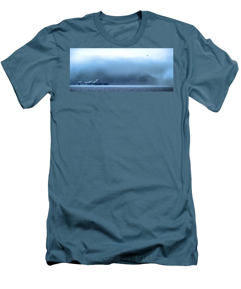 Pier Men's T-Shirt (Athletic Fit) featuring the photograph The Sea Mist Lifts To Reveal The Great Orme Behind Llandudno Pier by Mal Bray
