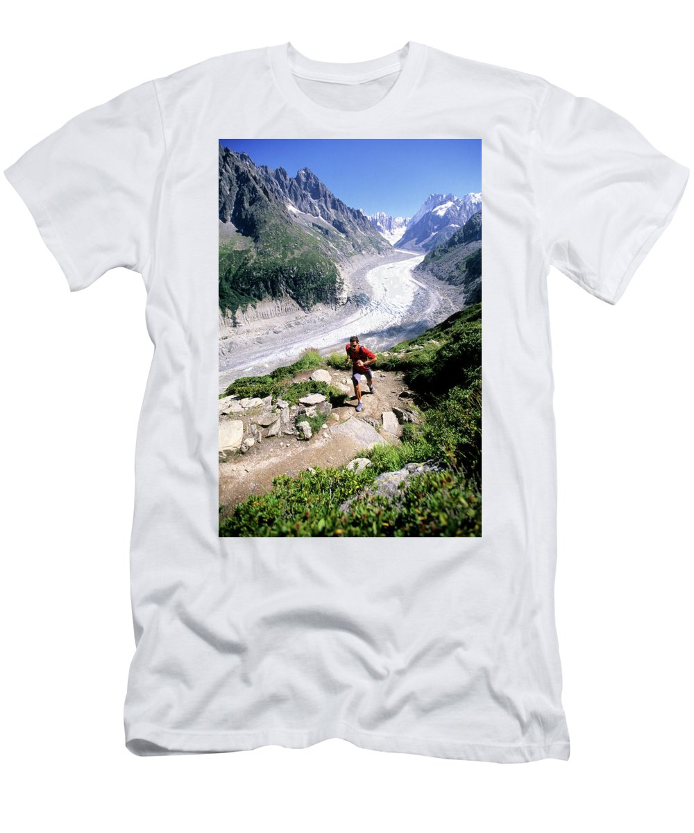 Action Men's T-Shirt (Athletic Fit) featuring the photograph A Man Trail Runs In Chamonix, France by Scott Markewitz
