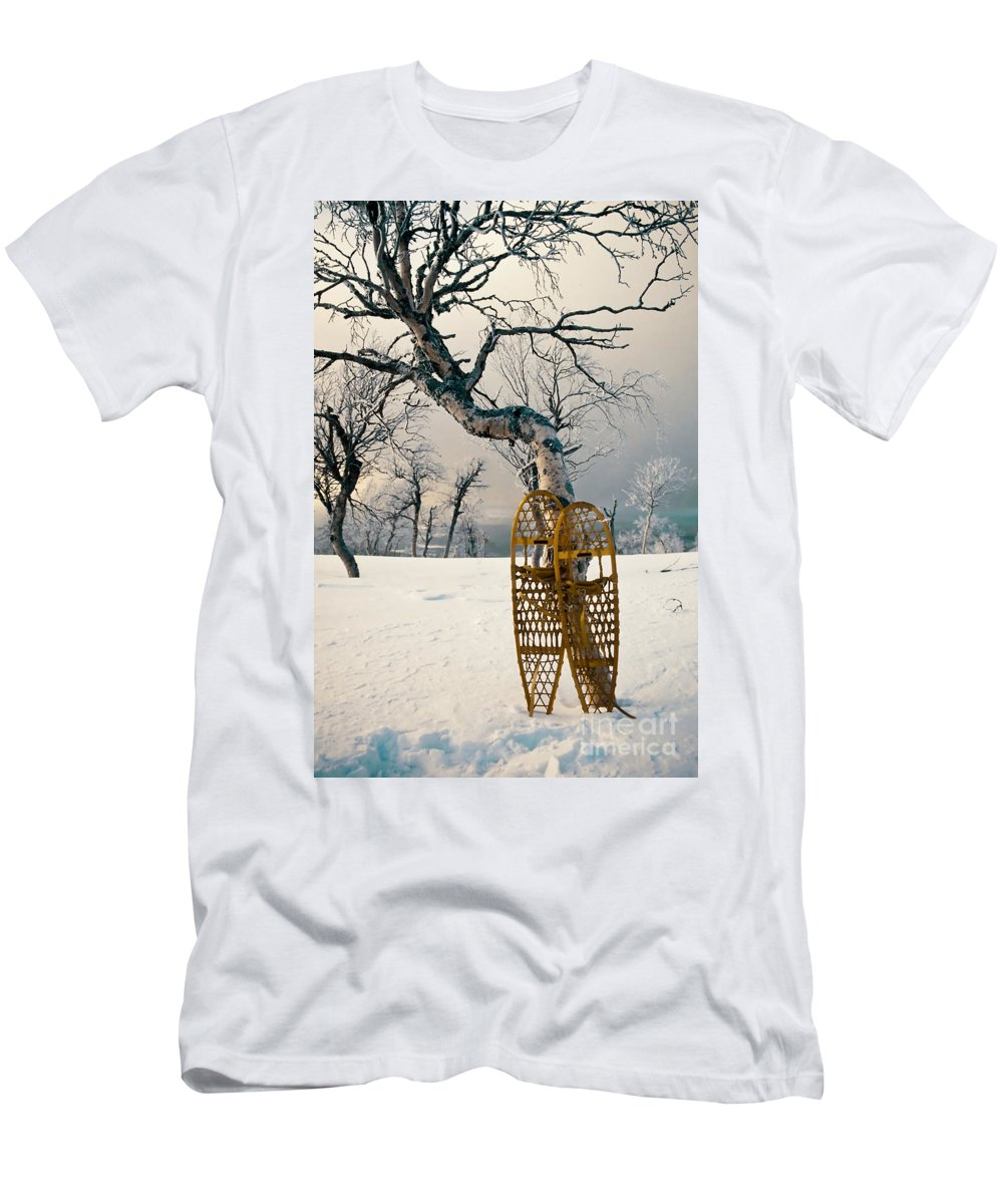 Alpine Men's T-Shirt (Athletic Fit) featuring the photograph Snowshoes Leaning Against Birch Tree Snowscape by Stephan Pietzko