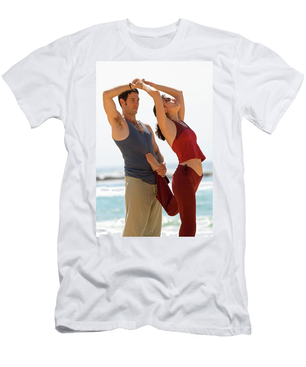 Assistence Men's T-Shirt (Athletic Fit) featuring the photograph A Man And Woman Practicing Yoga by Lars Schneider