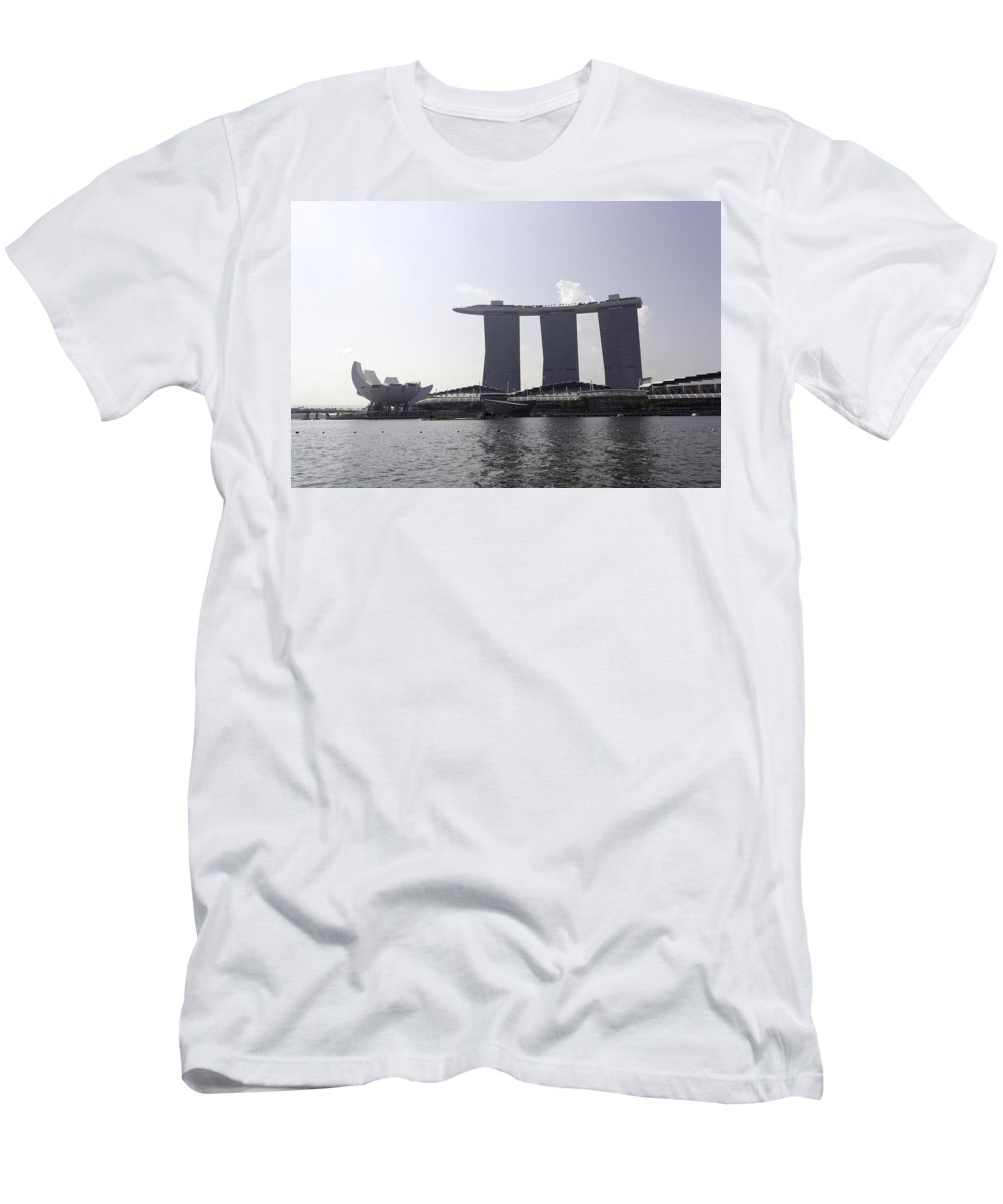 3 Towers Men's T-Shirt (Athletic Fit) featuring the photograph The Artscience Musuem And The Marina Bay Sands Resort In Singapore by Ashish Agarwal