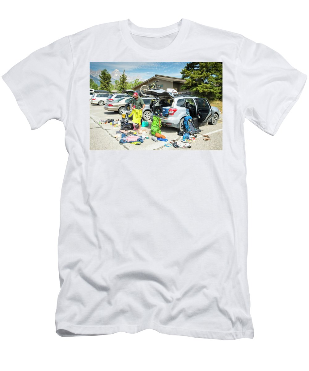 Day Men's T-Shirt (Athletic Fit) featuring the photograph A Backpacker Prepares His Gear by Rob Hammer