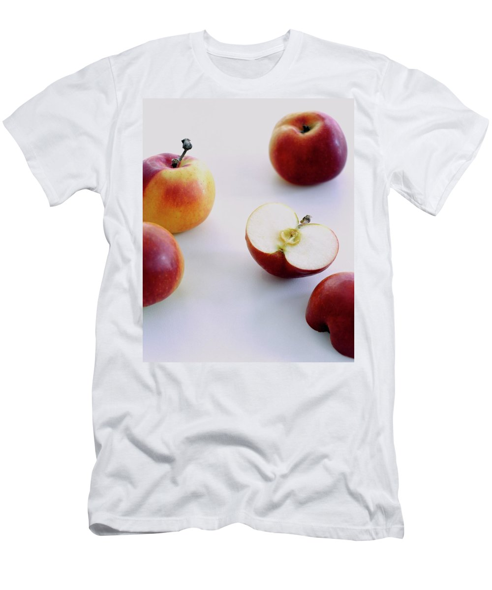 Fruits Men's T-Shirt (Athletic Fit) featuring the photograph A Group Of Apples by Romulo Yanes