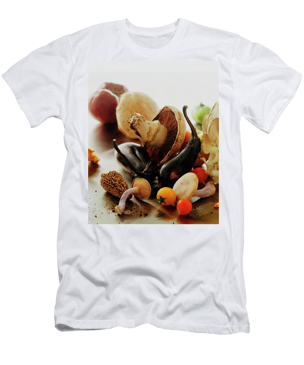 Vegetables Men's T-Shirt (Athletic Fit) featuring the photograph A Pile Of Vegetables by Romulo Yanes