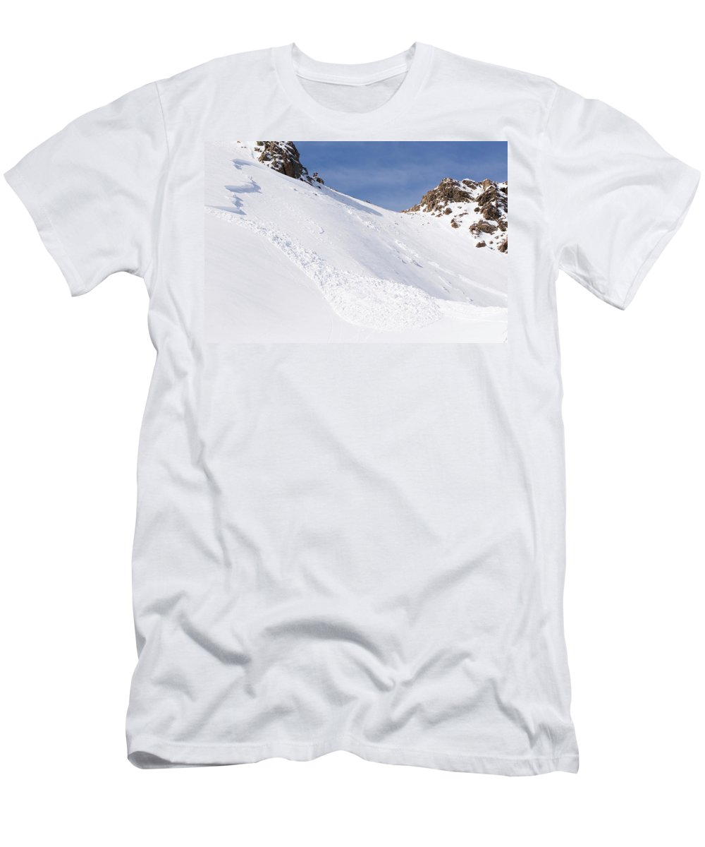 Absence Men's T-Shirt (Athletic Fit) featuring the photograph A Small Slab Avalanche With Two Guides by Jeff Curtes