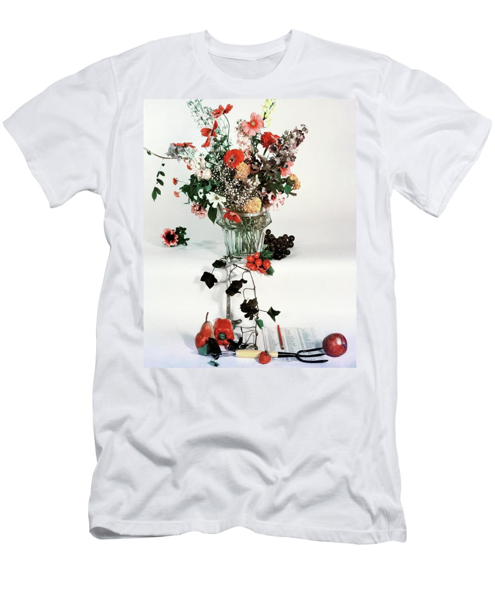 Nobody Men's T-Shirt (Athletic Fit) featuring the photograph A Studio Shot Of A Vase Of Flowers And A Garden by Herbert Matter