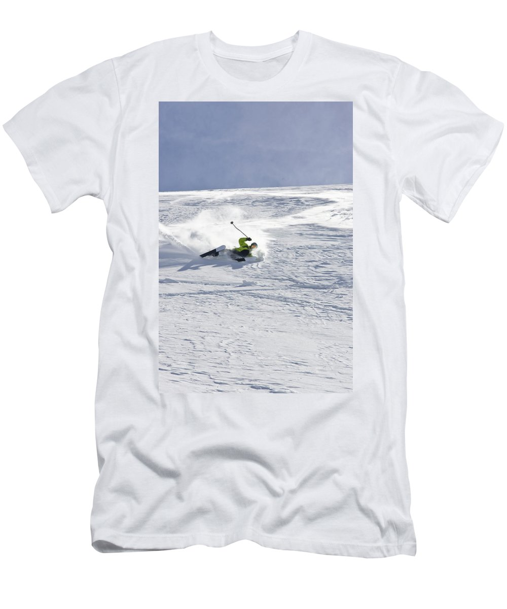 Accident Men's T-Shirt (Athletic Fit) featuring the photograph A Young Man Falls While Skiing by Henry Georgi