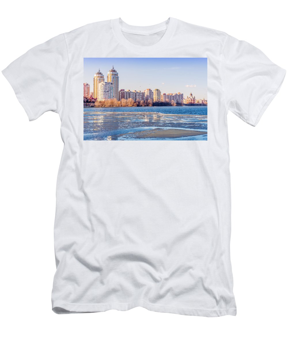 Dnipro Dnieper Men's T-Shirt (Athletic Fit) featuring the photograph Buildings Close To The Frozen River by Alain De Maximy