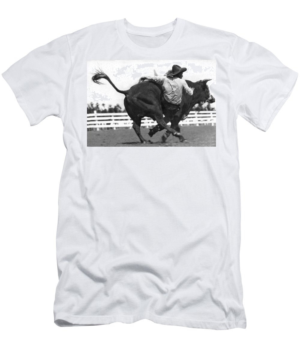 1 Person Men's T-Shirt (Athletic Fit) featuring the photograph Cowboy Falling From Bull by Underwood Archives