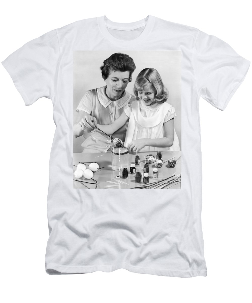 1960s Men's T-Shirt (Athletic Fit) featuring the photograph Dipping Easter Eggs by Underwood Archives