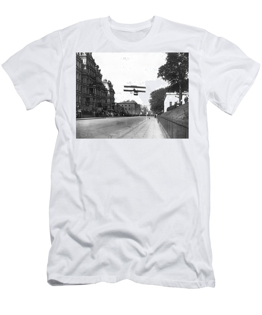 1910 Men's T-Shirt (Athletic Fit) featuring the photograph Early Biplane Flight by Underwood Archives