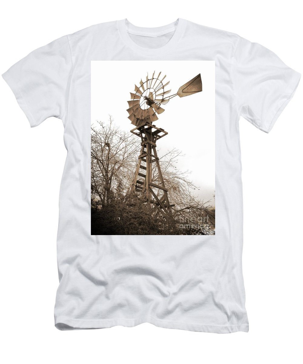 Windmill Men's T-Shirt (Athletic Fit) featuring the photograph Farm Windmill In Sepia by Carol Groenen