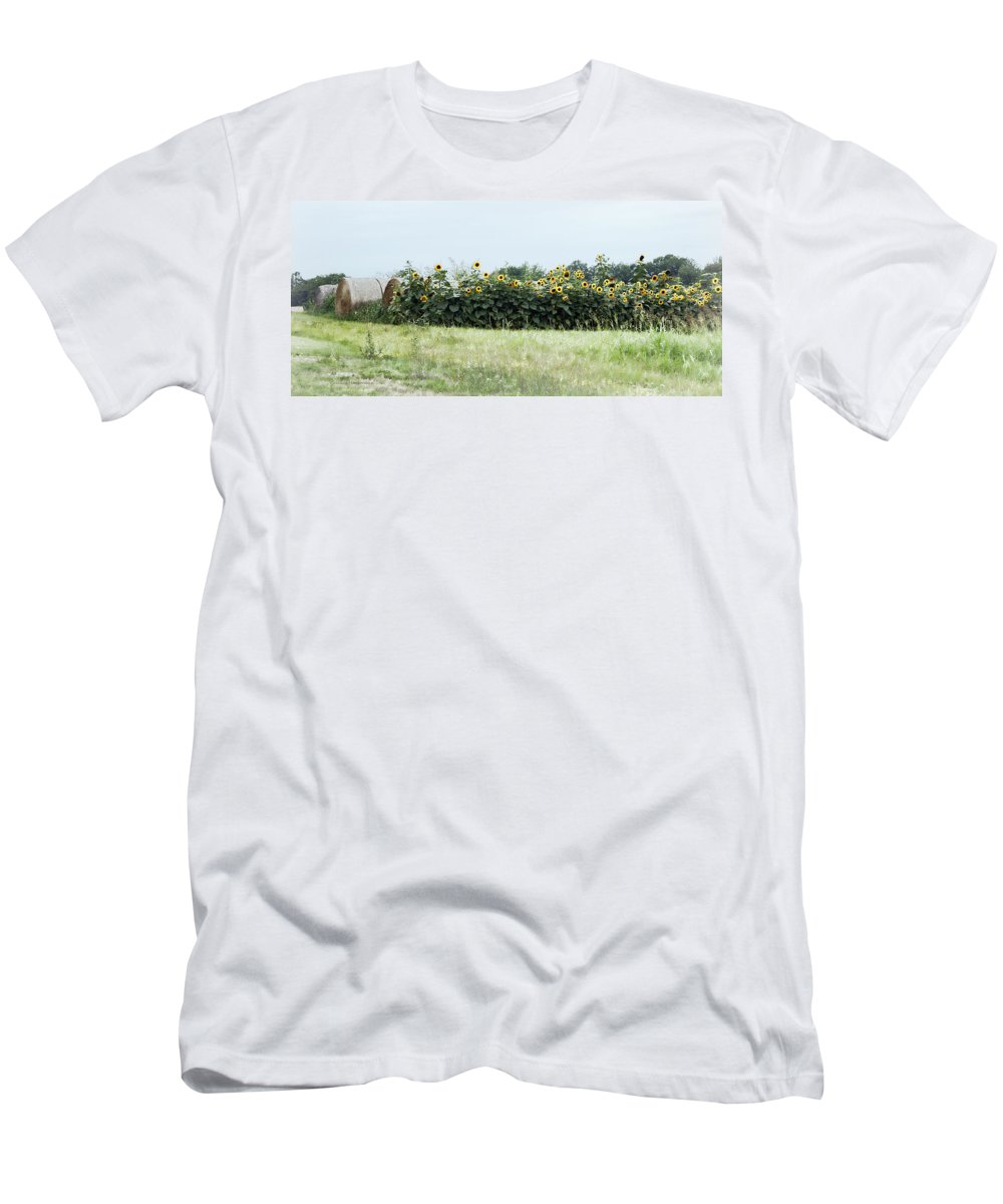 Hay Men's T-Shirt (Athletic Fit) featuring the photograph Hay Bales And Sunflowers by Cricket Hackmann
