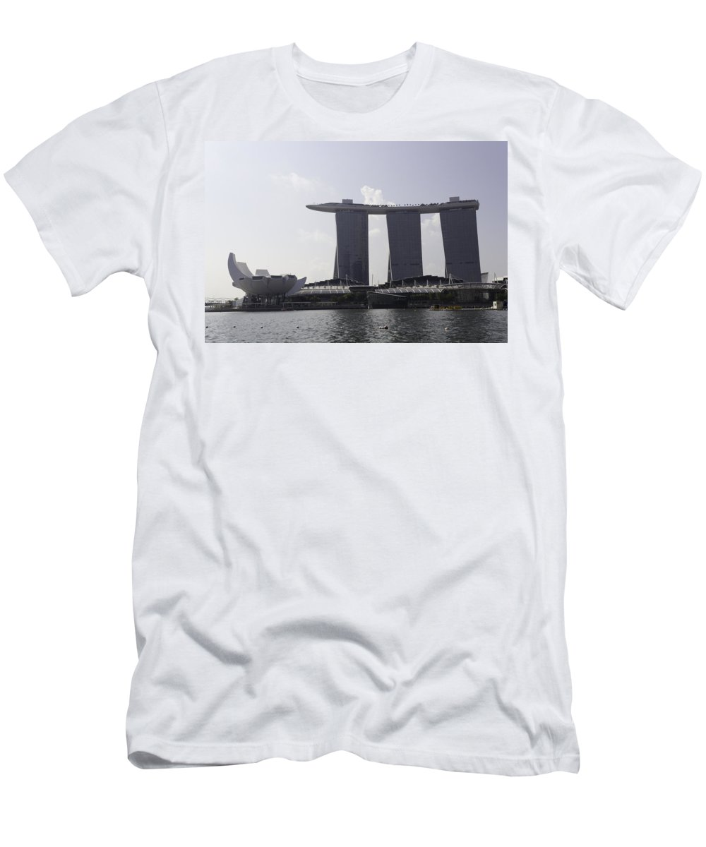 3 Towers Men's T-Shirt (Athletic Fit) featuring the photograph Iconic Structures Of Artscience Musuem And The Marina Bay Sands by Ashish Agarwal