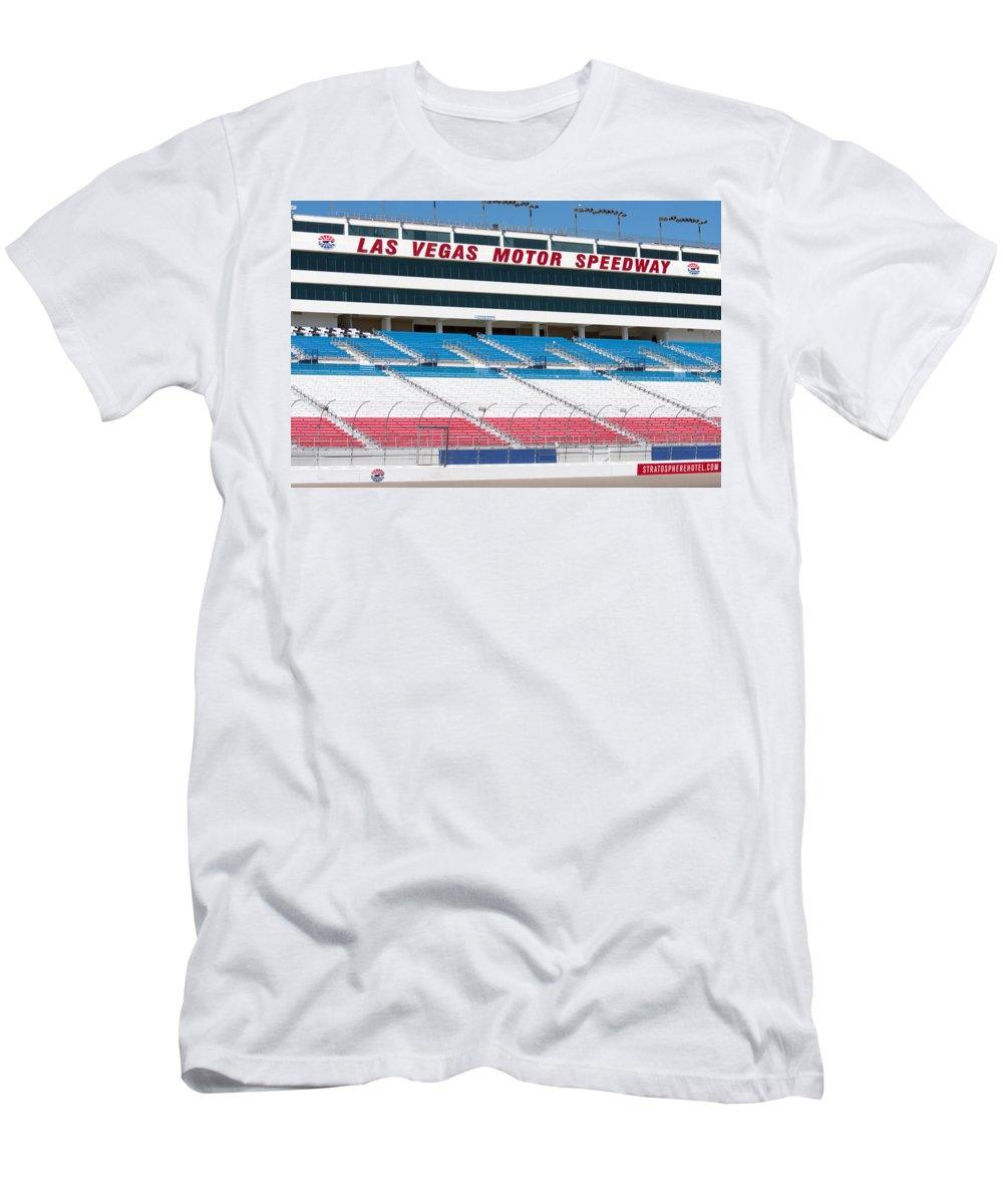 Bleachers Men's T-Shirt (Athletic Fit) featuring the photograph Las Vegas Speedway Grandstands by Gunter Nezhoda